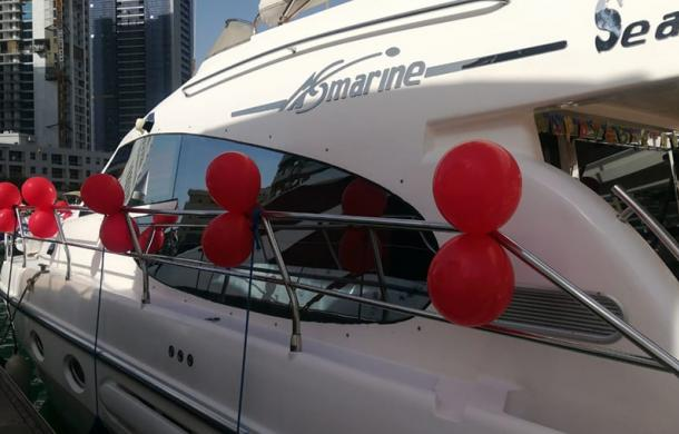 Birthday Yacht Decorated with red balloons
