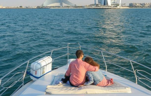 Romantic couple on a yacht deck near Burj al Arab