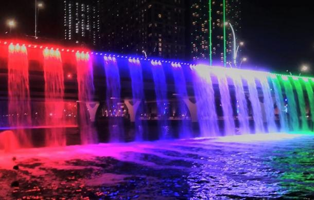 Dubai Canal colorful water fall